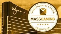 a scale showing Wynn resorts logo on one side and the logo of the Massachusetts Gaming Commission on the other side.
