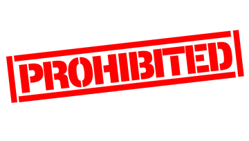 a red stamp saying Prohibited on a white background