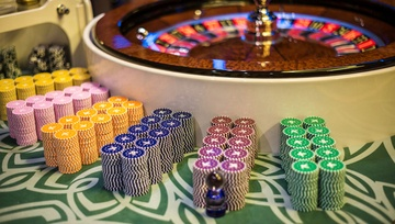 roulette wheel with piles of chips waiting for players