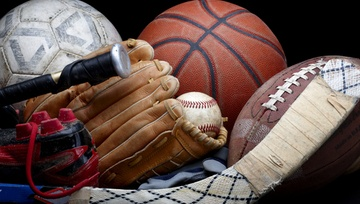 close up of sports equipment:  hockey, baseball, football, basketball